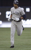 Alex Rodriguez of the New York Yankees rounds the bases after slugging a 3 run HR in the 3rd inning during the game against the Toronto Blue Jays...