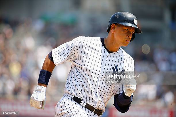 Alex Rodriguez of the New York Yankees rounds the bases after hitting a threerun home run against Chris Young of the Kansas City Royals in the third...