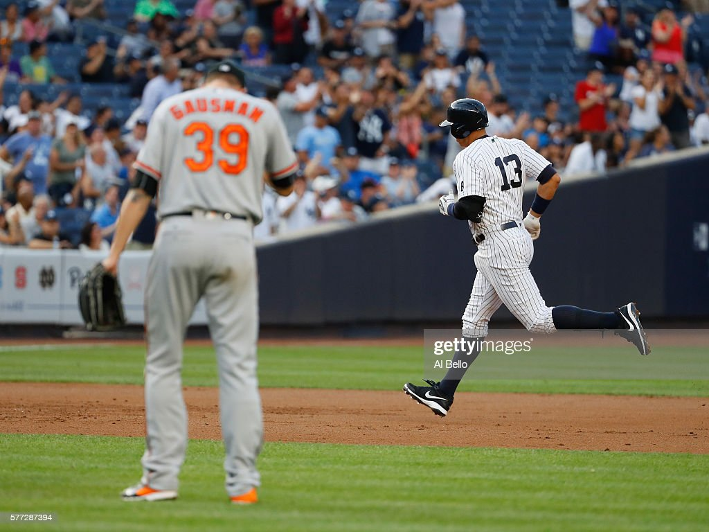 Alex Rodriguez #13 of the New York Yankees rounds the bases after hitting a home run against Kevin Gausman #39 of the Baltimore Orioles in the second inning during their game at Yankee Stadium on July 18, 2016 in New York City.