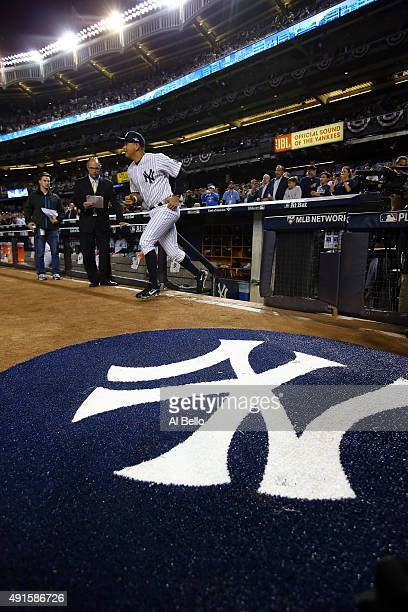 Alex Rodriguez of the New York Yankees runs on to the field prior to the American League Wild Card Game against the Houston Astros at Yankee Stadium...