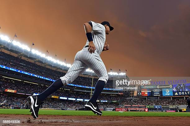 Alex Rodriguez of the New York Yankees runs onto the field to warm up before the game against the Tampa Bay Rays at Yankee Stadium on August 12 2016...