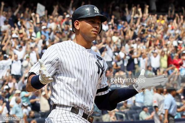 Alex Rodriguez of the New York Yankees runs the bases after hitting his 600th career home run in the first inning against Shaun Marcum of the Toronto...
