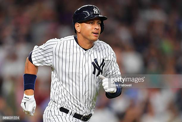 Alex Rodriguez of the New York Yankees runs to first base on a ground out in the seventh inning against the Tampa Bay Rays at Yankee Stadium on...