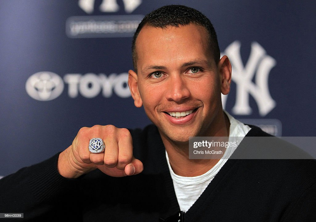 Alex Rodriguez #13 of the New York Yankees shows off his World Series ring to the media during a press conference after the Yankees home opener at Yankee Stadium on April 13, 2010 in the Bronx borough of New York City.