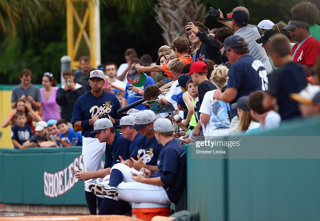Alex Rodriguez of the New York Yankess signs autographs after he is taken out of his game for the Charleston RiverDogs at Joseph P. Riley Jr. Park on July 2, 2013 in Charleston, South Carolina.