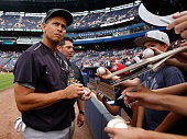 Alex Rodriguez of the New York Yankees signs autographs before the game against the Atlanta Braves at Turner Field on August 29 2015 in Atlanta...