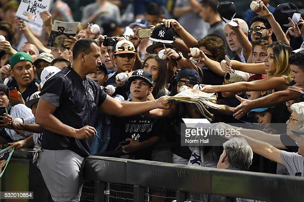 Alex Rodriguez of the New York Yankees signs autographs for fans down the right field line prior to a game against the Arizona Diamondbacks at Chase...