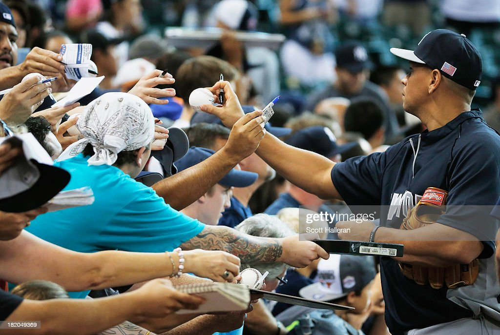 <a gi-track='captionPersonalityLinkClicked' href=/galleries/search?phrase=Alex+Rodriguez+-+Baseball+Player&family=editorial&specificpeople=167080 ng-click='$event.stopPropagation()'>Alex Rodriguez</a> #13 of the New York Yankees signs autographs for fans on the field before the game against the Houston Astros at Minute Maid Park on September 27, 2013 in Houston, Texas.