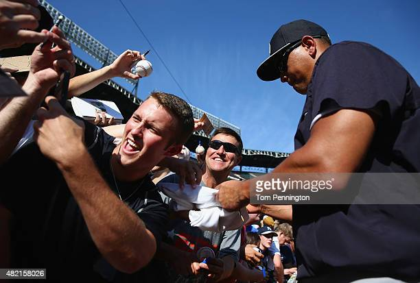 Alex Rodriguez of the New York Yankees signs autographs for fans during batting practice before taking on the Texas Rangers at Globe Life Park in...