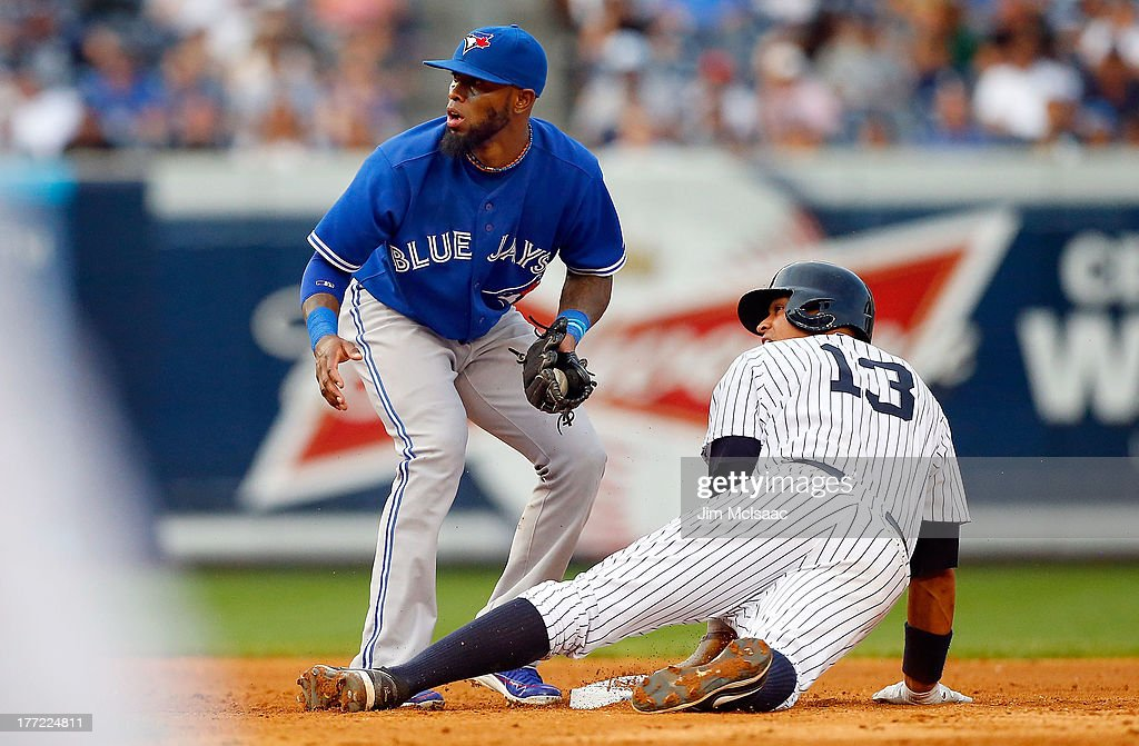 Alex Rodriguez #13 of the New York Yankees steals second base in the sixth inning against Jose Reyes #7 of the Toronto Blue Jays at Yankee Stadium on August 22, 2013 in the Bronx borough of New York City.