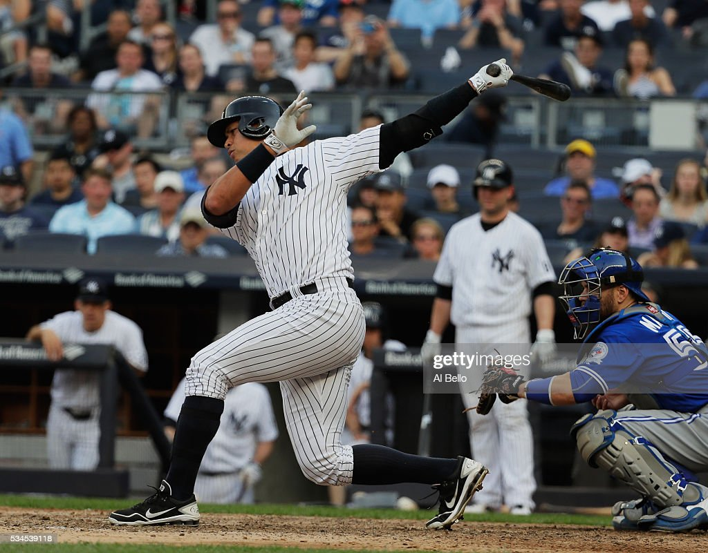 <a gi-track='captionPersonalityLinkClicked' href=/galleries/search?phrase=Alex+Rodriguez&family=editorial&specificpeople=167080 ng-click='$event.stopPropagation()'>Alex Rodriguez</a> #13 of the New York Yankees strikes out to end the game in a 3-1 loss to the Toronto Blue Jays during their game at Yankee Stadium on May 26, 2016 in New York City.