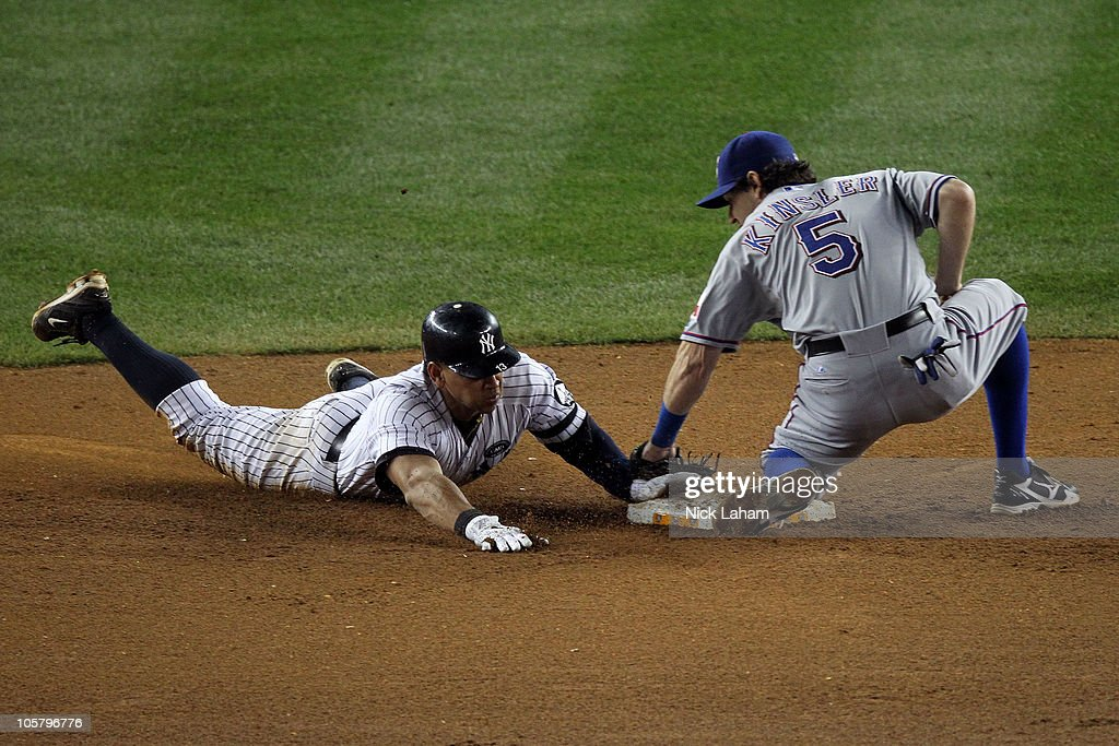 Alex Rodriguez #13 of the New York Yankees successfully steals second base against Ian Kinsler #5 of the Texas Rangers in Game Five of the ALCS during the 2010 MLB Playoffs at Yankee Stadium on October 20, 2010 in the Bronx borough of New York City.