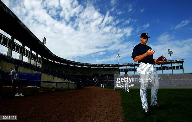 Alex Rodriguez of the New York Yankees takes a break from playing catch with teammate Derek Jeter during practice on February 25 2004 at the Yankees...