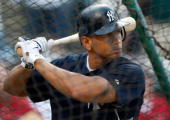 Alex Rodriguez of the New York Yankees takes batting practice in the cage against the Cleveland Indians during Game One of the American League...