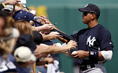 Alex Rodriguez of the New York Yankees takes time to sign autographs for fans prior to a Spring Training game against the Pittsburgh Pirates on March...