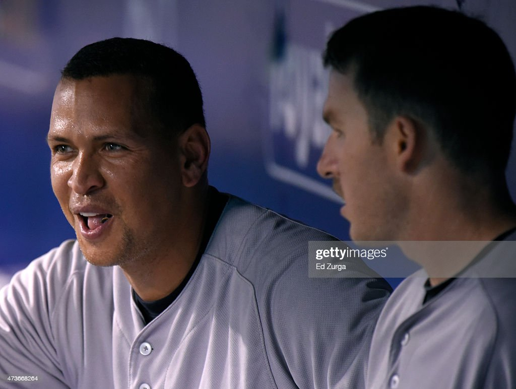 Alex Rodriguez #13 of the New York Yankees talks with Stephen Drew #14 in the dugout after hitting a home run in the ninth inning against the Kansas City Royals at Kauffman Stadium on May 16, 2014 in Kansas City, Missouri.