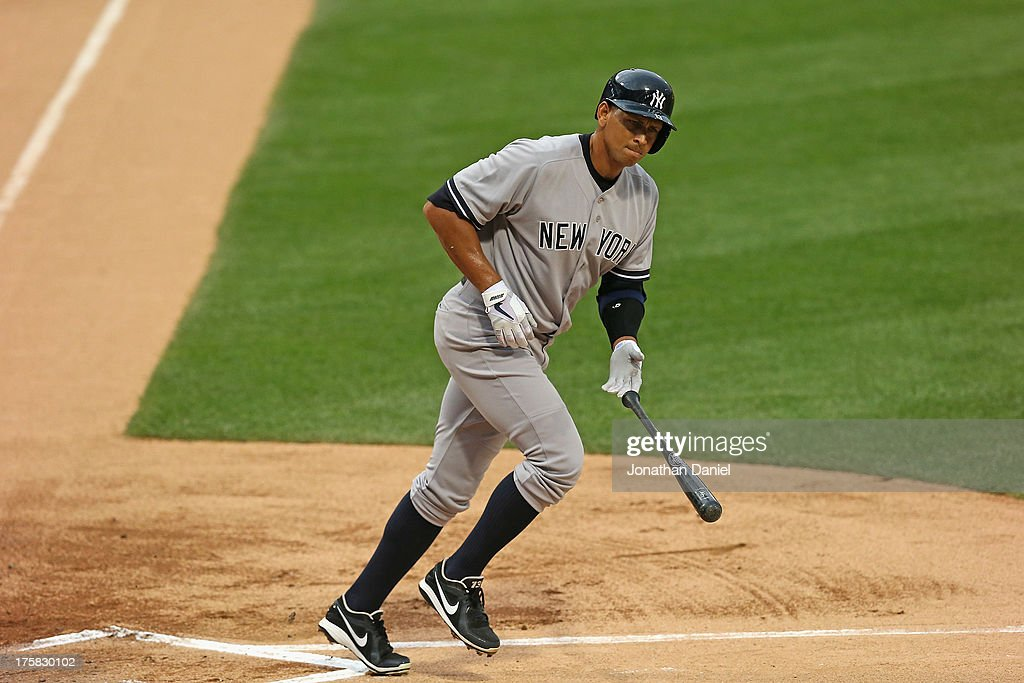 Alex Rodriguez #13 of the New York Yankees tosses his bat after drawing a walk in the 1st inning against the Chicago White Sox at U.S. Cellular Field on August 6, 2013 in Chicago, Illinois.