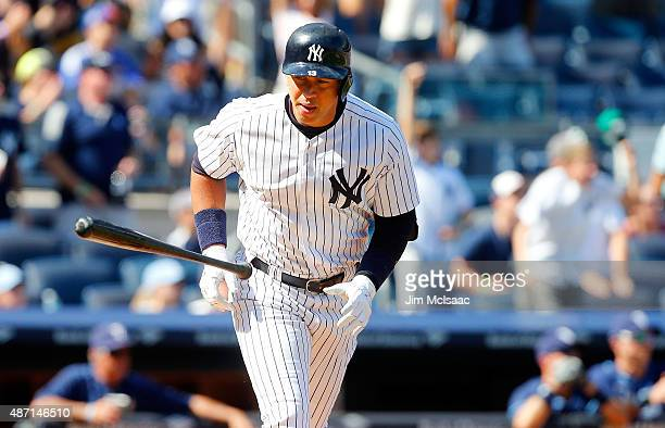 Alex Rodriguez of the New York Yankees tosses his bat and runs the bases after his sixth inning home run against the Tampa Bay Rays at Yankee Stadium...