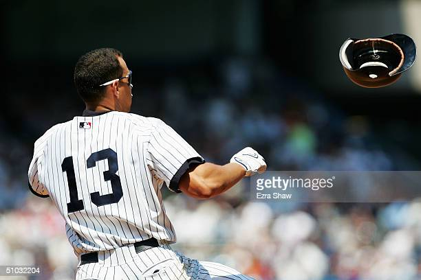Alex Rodriguez of the New York Yankees tosses his helmet after just missing a home run in the third inning against the Detroit Tigers on July 7 2004...