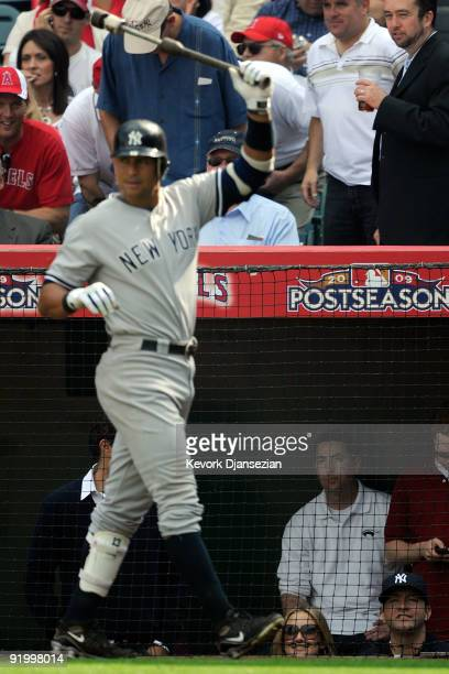 Alex Rodriguez of the New York Yankees waits on deck during the forth inning as actress Kate Hudson looks on in Game Three of the ALCS against the...