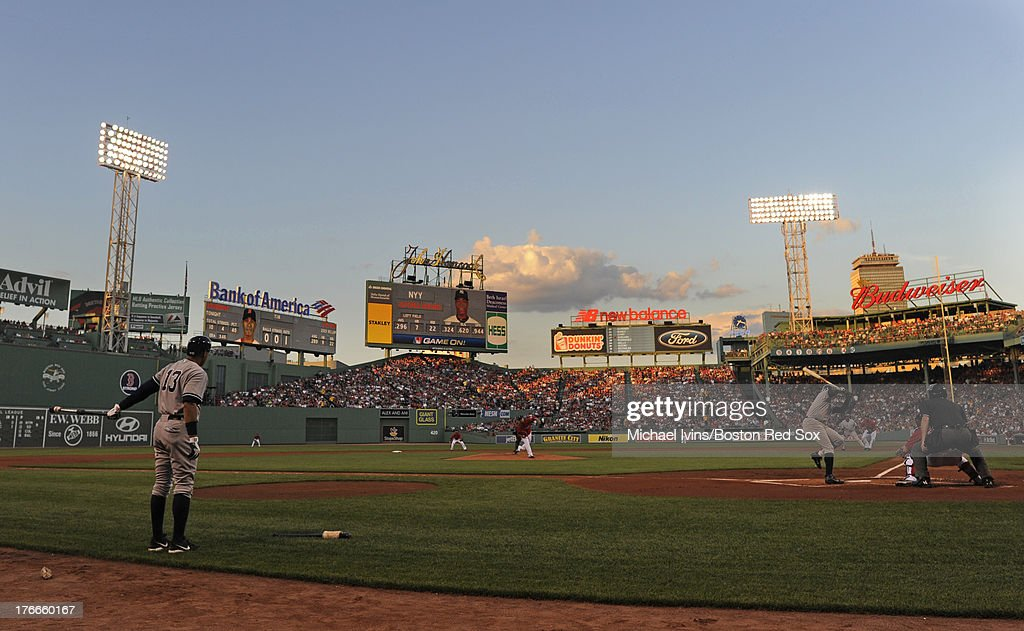 Alex Rodriguez #13 of the New York Yankees waits on deck while Alfonso Soriano #12 bats against Felix Dourbont # 22 of the Boston Red Sox during the first inning on August 16, 2013 at Fenway Park in Boston Massachusetts.