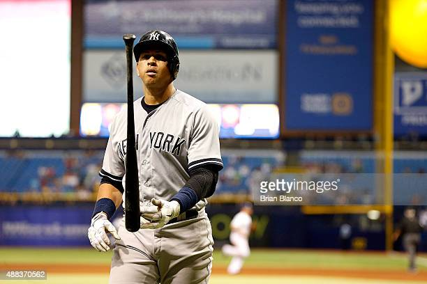Alex Rodriguez of the New York Yankees walks back to the dugout after striking out looking to end the top of the fifth inning of a game against the...