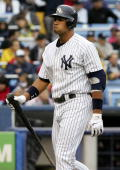 Alex Rodriguez of the New York Yankees walks back to the dugout after striking out against the Minnesota Twins at Yankee Stadium September 2 2006 in...