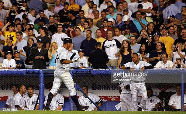 Alex Rodriguez of the New York Yankees walks back to the dugout after his fifth at bat as Derek Jeter looks on against the Chicago White Sox on July...