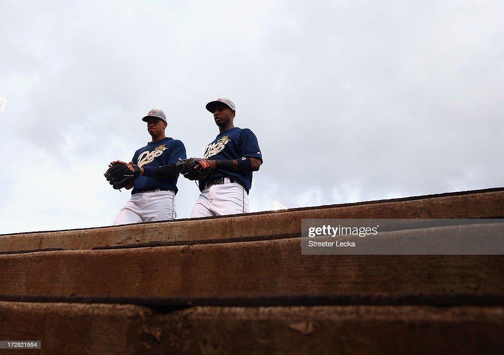 Alex Rodriguez of the New York Yankees walks off the field with Eduardo Nunez at Joseph P. Riley Jr. Park on July 2, 2013 in Charleston, South Carolina.