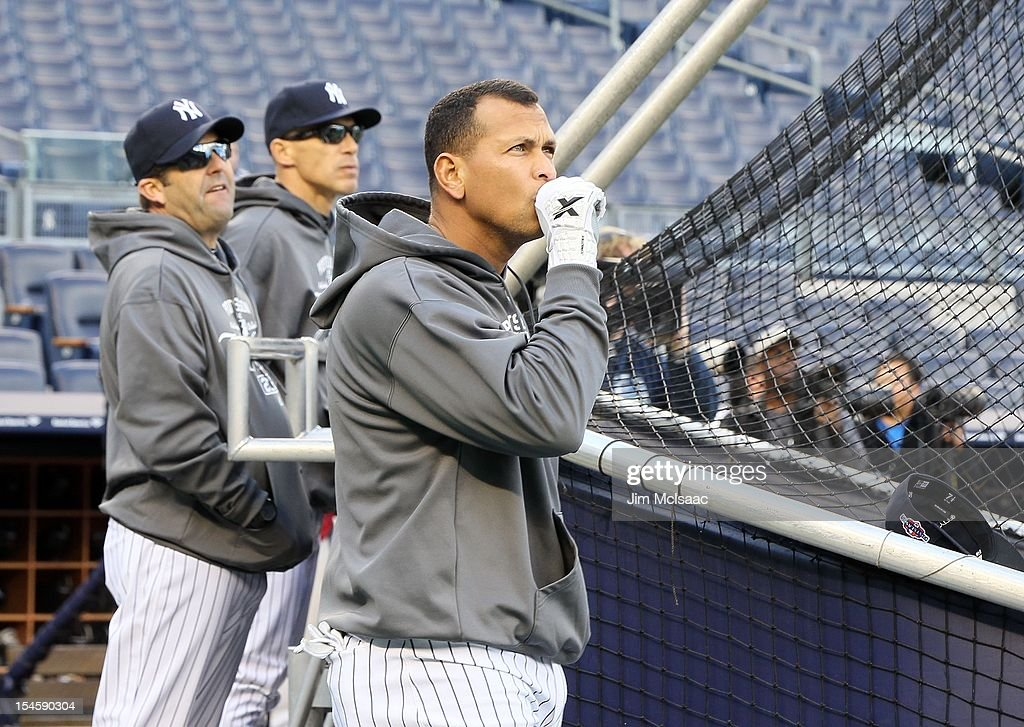 Alex Rodriguez #13 of the New York Yankees warms up before Game Five of the American League Division Series against the Baltimore Orioles as hitting coach Kevin Long (L) and manager Joe Girardi look onat Yankee Stadium on October 12, 2012 in the Bronx borough of New York City. The Yankees defeated the Orioles 3-1 to win their best of five series three games to two.