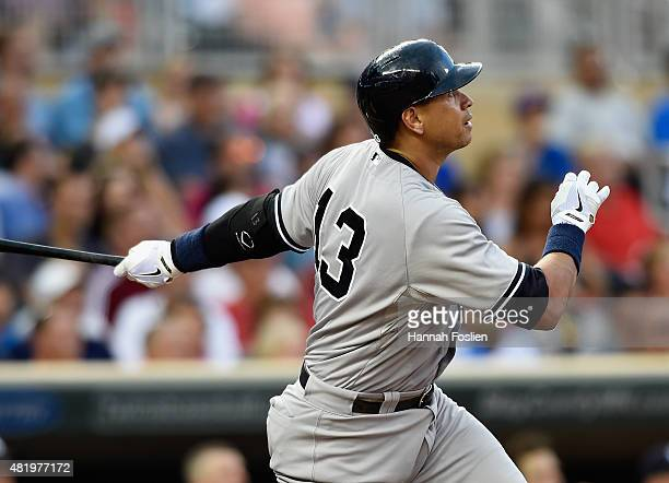 Alex Rodriguez of the New York Yankees watches after hitting a tworun home run against the Minnesota Twins during the seventh inning of the game on...