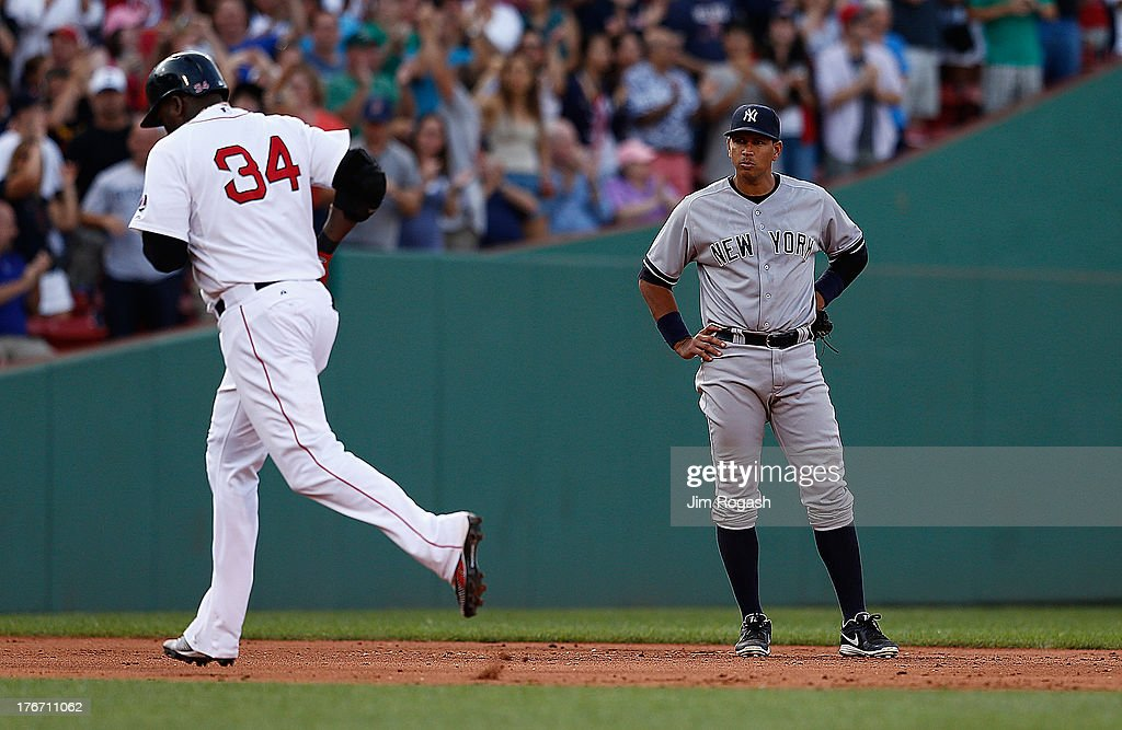 Alex Rodriguez #13 of the New York Yankees watches as David Ortiz #34 of the Boston Red Sox rounds the bases after hitting a home run in the 7th inning at Fenway Park on August 17, 2013 in Boston, Massachusetts.
