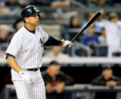 Alex Rodriguez of the New York Yankees watches his hit fly out of the park and turn into a grand slam in the seventh inning against the San Francisco...