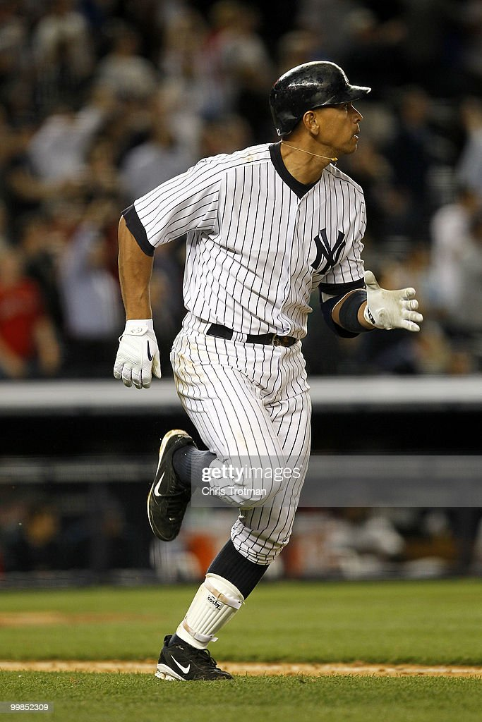 Alex Rodriguez #13 of the New York Yankees watches his two-run home run in the ninth inning against the Boston Red Sox on May 17, 2010 at Yankee Stadium in the Bronx borough of New York City. The Yankees defeated the Red Sox 11-9.