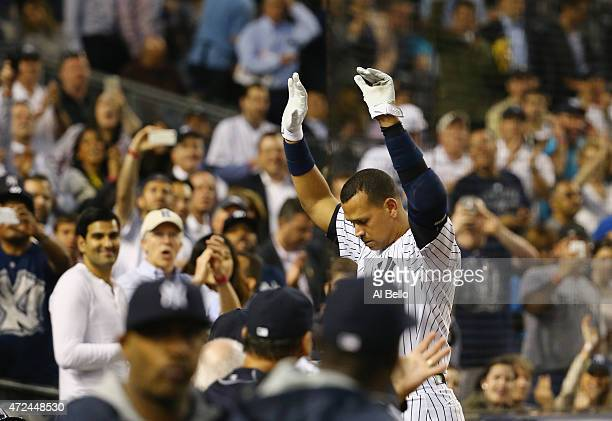 Alex Rodriguez of the New York Yankees waves to the crowd after hitting his 661st home run against Chris Tillman of the Baltimore Orioles in the...