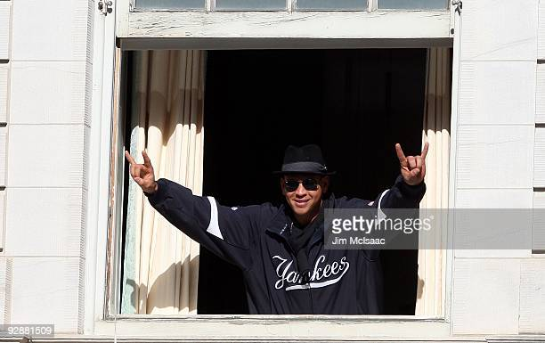 Alex Rodriguez of the New York Yankees waves to the crowd during the New York Yankees World Series Victory Celebration at City Hall on November 6...
