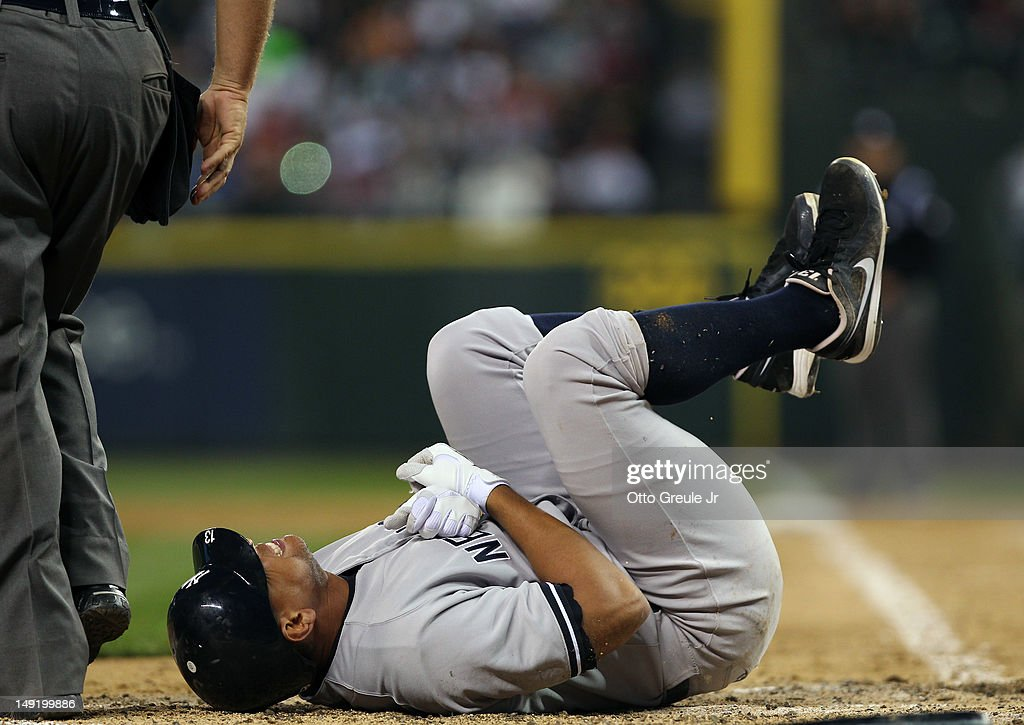 Alex Rodriguez #13 of the New York Yankees writhes in pain after being hit with a pitch on the arm by starting pitcher Felix Hernandez of the Seattle Mariners at Safeco Field on July 24, 2012 in Seattle, Washington. Rodriguez was removed from the game.