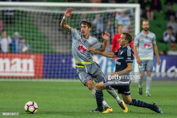 Alex Rodriguez of the Wellington Phoenix and Alan Baro of Melbourne Victory contest the ball during the round 25 match of the Hyundai ALeague between...