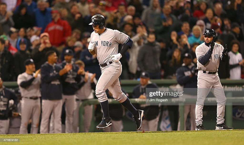 Alex Rodriguez #13 rounds the bases after hit his 660th career home run to tie Willie Mays record during a game with Boston Red Sox in the 8th inning at Fenway Park May 1, 2015 in Boston, Massachusetts.