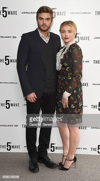 Alex Roe and Chloe Grace Moretz pose at a photocall for 'The 5th Wave' at The Soho Hotel on January 21 2016 in London England