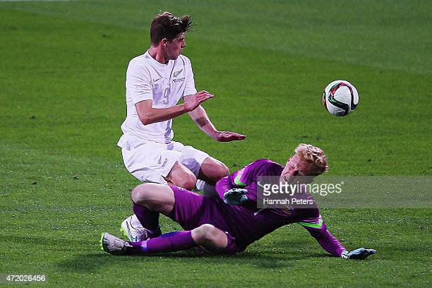 Alex Rufer of New Zealand dives over the top of Thomas Glover of Australia during the U20 Five Nations match between New Zealand and Australia at QBE...