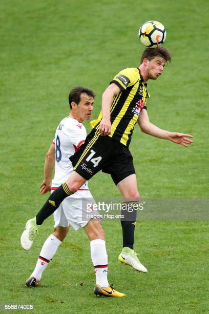 Alex Rufer of the Phoenix wins a header over Isaias of Adelaide United during the round one ALeague match between Wellington Phoenix and Adelaide...