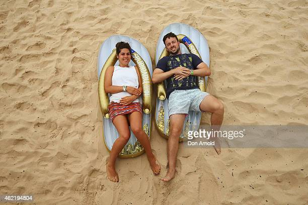 Alex Russell and Alex RemanClarke pose whilst lying on their Havaianas during the Havaianas Australia Day Thong Challenge at Bondi Beach on January...