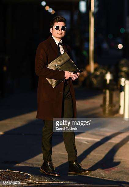 Alex Salcedo is seen wearing a burgundy jacket gray pants striped socks black boots and a black bag outside of New York Men's Day during New York...