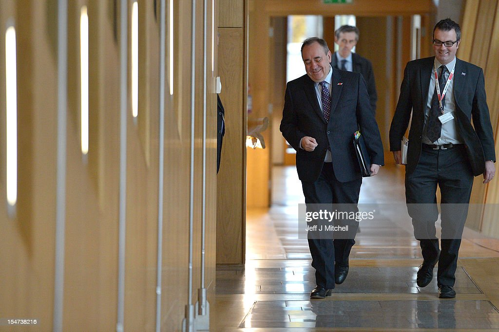 Alex Salmond First Minister of Scotland (L) arrives fir First Ministers Questions at the Scottish Parliament on October 25, 2012 in Edinburgh, Scotland. The First Minister answered questions from the opposition parties on the row over whether the SNP government had held legal advice on the EU status of an independent Scotland.
