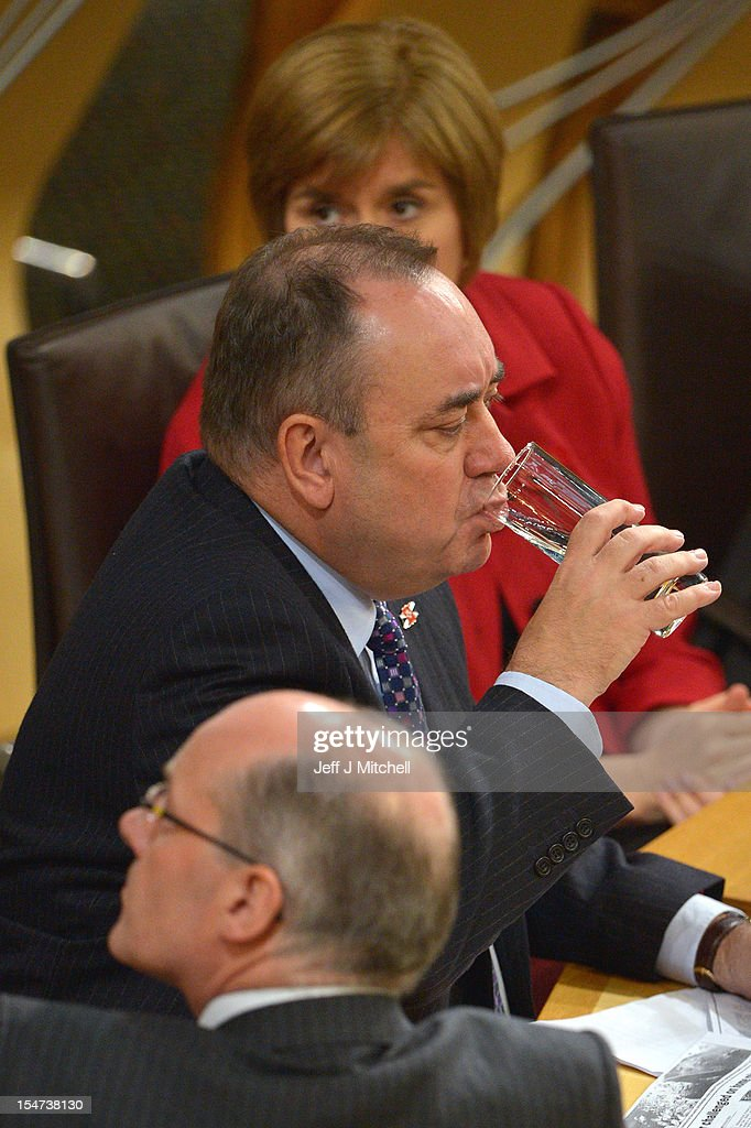 <a gi-track='captionPersonalityLinkClicked' href=/galleries/search?phrase=Alex+Salmond&family=editorial&specificpeople=857688 ng-click='$event.stopPropagation()'>Alex Salmond</a> First Minister of Scotland drinks a glass of water while taking questions at the Scottish Parliament on October 25, 2012 in Edinburgh, Scotland. The First Minister answered questions from the opposition parties on the row over whether the SNP government had held legal advice on the EU status of an independent Scotland.