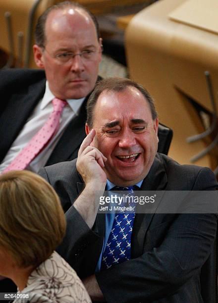 Alex Salmond Scotland's First Minister sits in the Scottish Parliament with deputy leader Nicola Sturgeon and finance secretary John Swinney after...