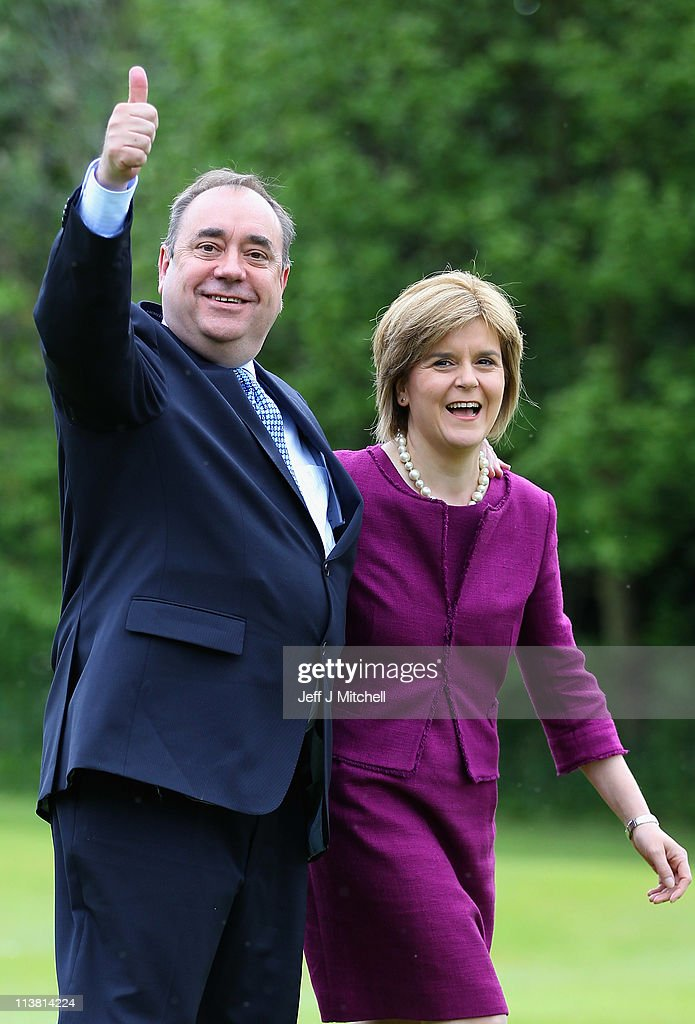 Alex Salmond, Scottish National Party Leader and Scotland's First Minister (L) arrives with Deputy Scottish National Party Leader Nicola Sturgeon to deliver his victory speech at Prestonfield House on May 6, 2011 in Edinburgh. The SNP has secured an unprecedented victory in the Scottish Parliament elections winning 69 seats in the 129 seat parliament.