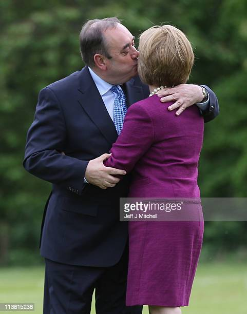 Alex Salmond Scottish National Party Leader and Scotland's First Minister kisses Scottish National Party Deputy Leader Nicola Sturgeon as he arrives...