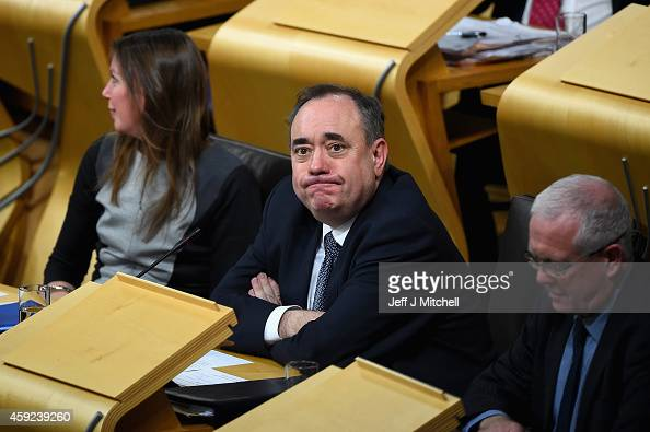 Alex Salmond takes a seat in the chamber as SNP leader Nicola Sturgeon is formally voted in as first minister of Scotland at the Scottish Parliament...